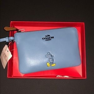Disney Coach wristlet. NWT. IN BOX!!